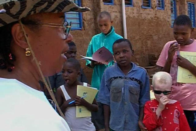 picture of Dr. Bath promises to help children at Mwereni in Tanzania