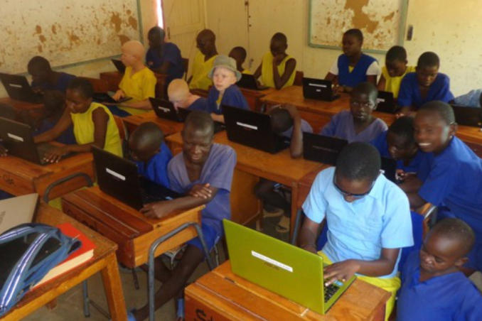 picture of Kenya St. Oda Students diligently doing homework aided by assistive technology
